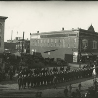 Soldiers lined-up in formation with band, Defiance, Ohio, 1919
