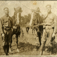 Daniel H. McCullough with unidentified man and horses at Camp Sheridan