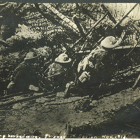 """Encountering barbed wire. Thiaucourt Sector. Nov. 1918."""