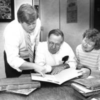 Staff assisting patrons at the Center for Archival Collections