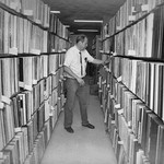 Bill Schurk in Music Library and Sound Recordings Archives stacks