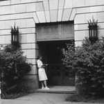 Student stands outside the Old Library
