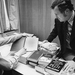 Dr. Ray Browne and Bill Schurk examining materials for the Popular Culture Library
