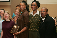 Sheila Brown, recipient of Miguel Ornelas Award, with Professor Peg Yacobucci, Sylvia Chandler, and other conference attendees