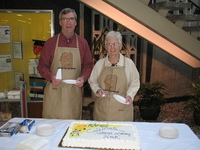 Robert Graham and Janet Parks serving cake during National Library Week