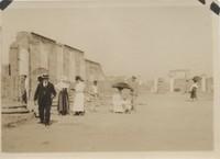 Tourists Walking Among Ruins of Pompeii