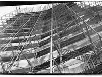 Artist Donald Drumm on scaffolding during Jerome Library construction