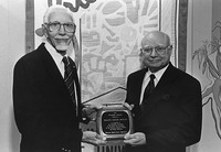 Dr. Ralph Wolfe receiving Friends of the University Libraries award